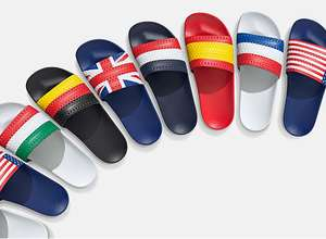 Nieuw binnen: Adidas Adilette vlag badslippers - met 25% korting door code @ Adidas
