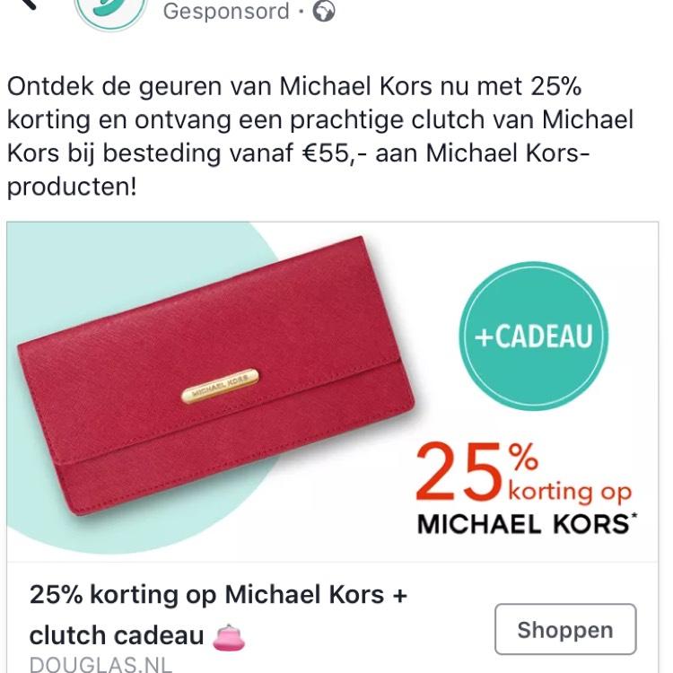 Gratis Clutch of Toilettas bij Douglas van Mickael Kors