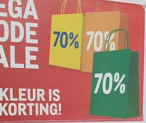 Makro alle mode met sale label 70%
