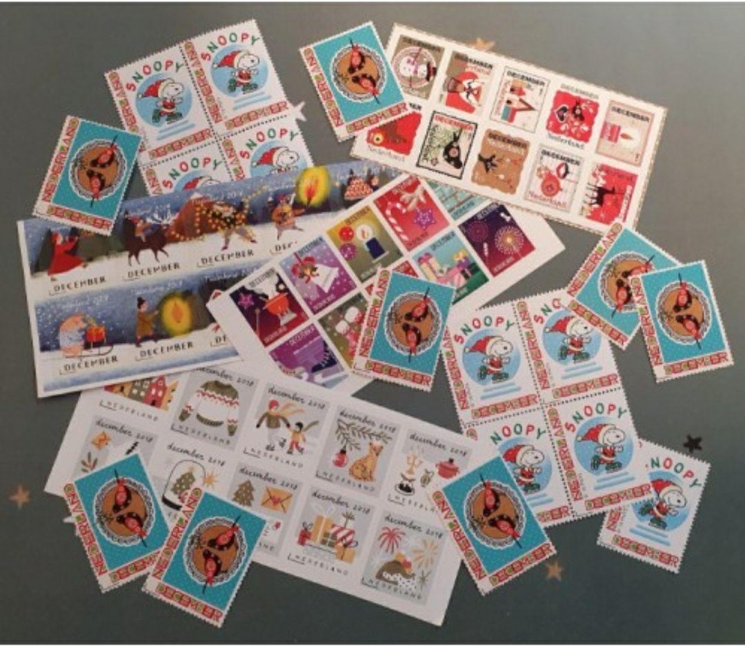 Decemberzegels: extra voordelig bij postzegelsmetkorting.nl - postzegels voor de feestdagen (kerstkaarten)