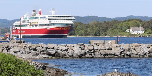 2 reizen met de auto vanaf Denemarken naar Noorwegen voor 60,- retourticket voor 5 personen.